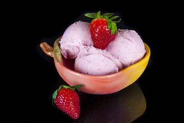 Strawberry ice cream in a bowl.