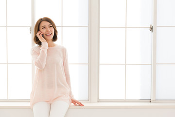 young asian woman talking