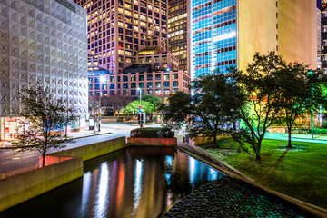 Buildings and pond at Thanks-Giving Square at night in Dallas, T