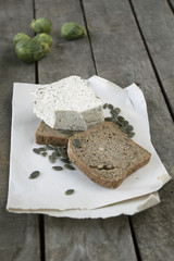 unleavened bread with pumpkin seed and tofu cheese