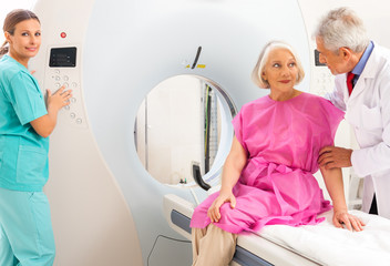 Mature female patient in 60s instructed by doctors about mri sca