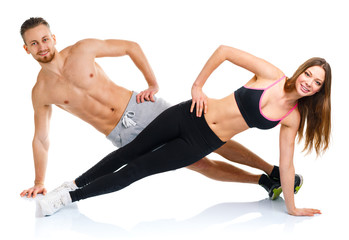 Sport attractive couple - man and woman doing fitness exercises