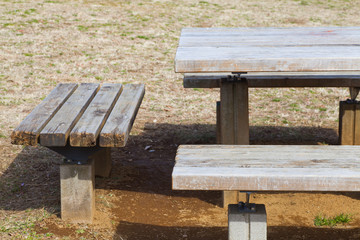 Wooden bench and wood table at green park