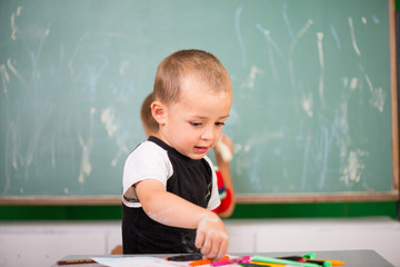 Little boy playing in a classroom