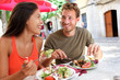 Restaurant tourists couple eating at outdoor cafe - 78230635
