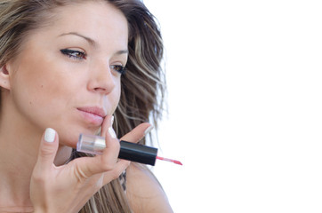 Woman with pretty face do her makeup, isolated on white