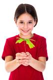 Girl with oak sapling in hands