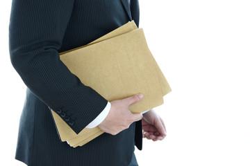 ビジネスイメージ―会議用資料を運ぶビジネスマン