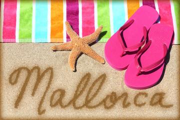 Mallorca beach vacation writing on sand