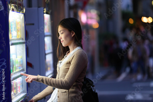 Japan vending machines - Tokyo woman buying drinks - 78231474