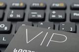 VIP credit card on black keyboard, online spending concept poster
