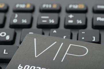 VIP credit card on black keyboard, online spending concept