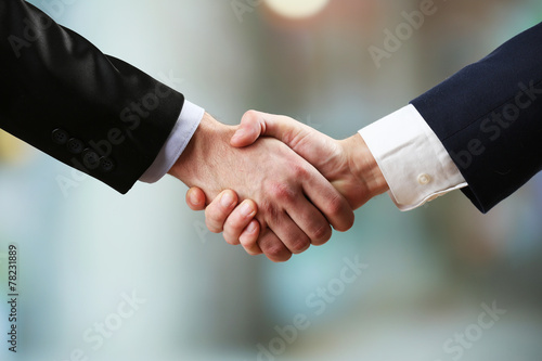 canvas print picture Business handshake on bright background