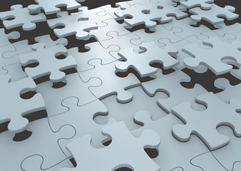 Puzzle pieces connecting to form a solution to a challenge