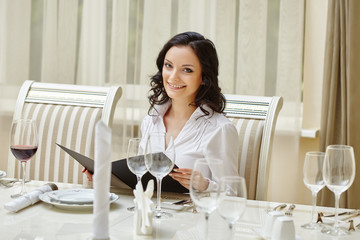 Smiling brunette posing during business lunch