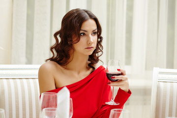 Elegant brunette over dinner in restaurant