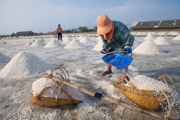 Farmer working in the salt field in Thailand