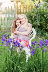 daughter with her mother in the garden