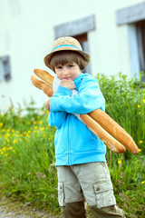 the boy with two baguettes on the street