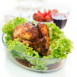 Whole roasted chicken with green salad and glass of vine