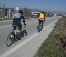 bikers on asphalt, man woman,sunny day