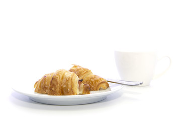 Croissant with ham sliced and cup of coffee for breakfast