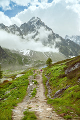 the trail to the glacier Argentiere in the mountains