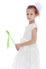 Elegant little girl with a magic wand.