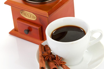 coffee beans with wooden coffee grinder and coffee cup.