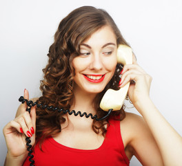 young  woman with vintage phone.