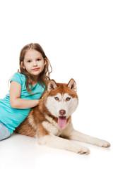 Girl with a siberian husky