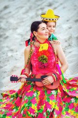 girl playing the guitar on sand background