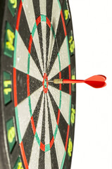 Darts arrows in the target center. isolated over white