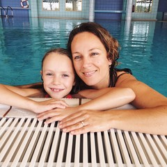Mother and daughter in swimming pool