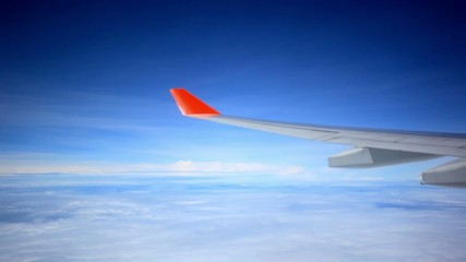 Looking through window aircraft during flight in wing with a
