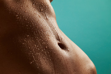 Beautiful woman's body with drops of water