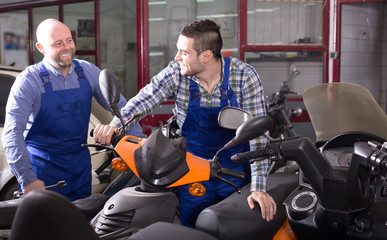 Specialists working with motocycles