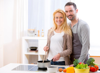 Young attractive couple cooking in a kitchen