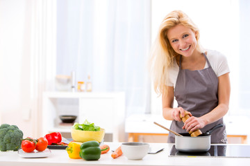 Young attractive woman cooking in a kitchen