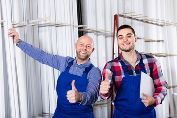 Two smiling workmen at factory