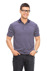 Cheerful young guy with glasses posing
