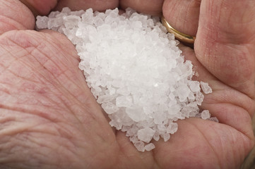 man hand with a little 'of sea salt