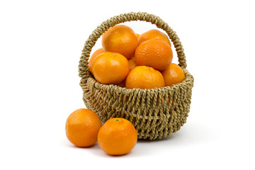 tangerines in a basket on white background