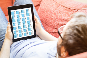 man telecommuting with tablet