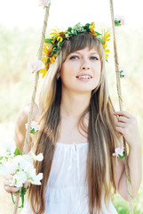 Beautiful Girl with Flowers Wreath at Summer