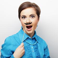 Girl wearing fake mustaches.