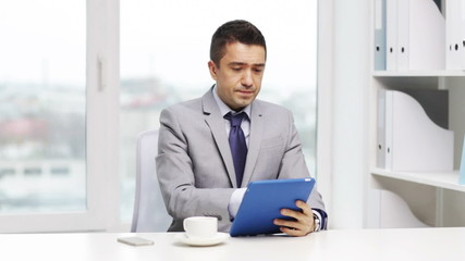 businessman with tablet pc and coffee cup