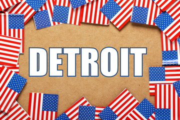 The title Detroit with a border of USA Flags
