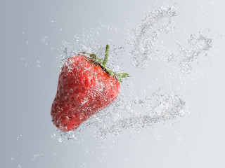 Ripe red strawberry splashing into water