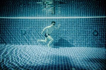 Man runs underwater swimming pool